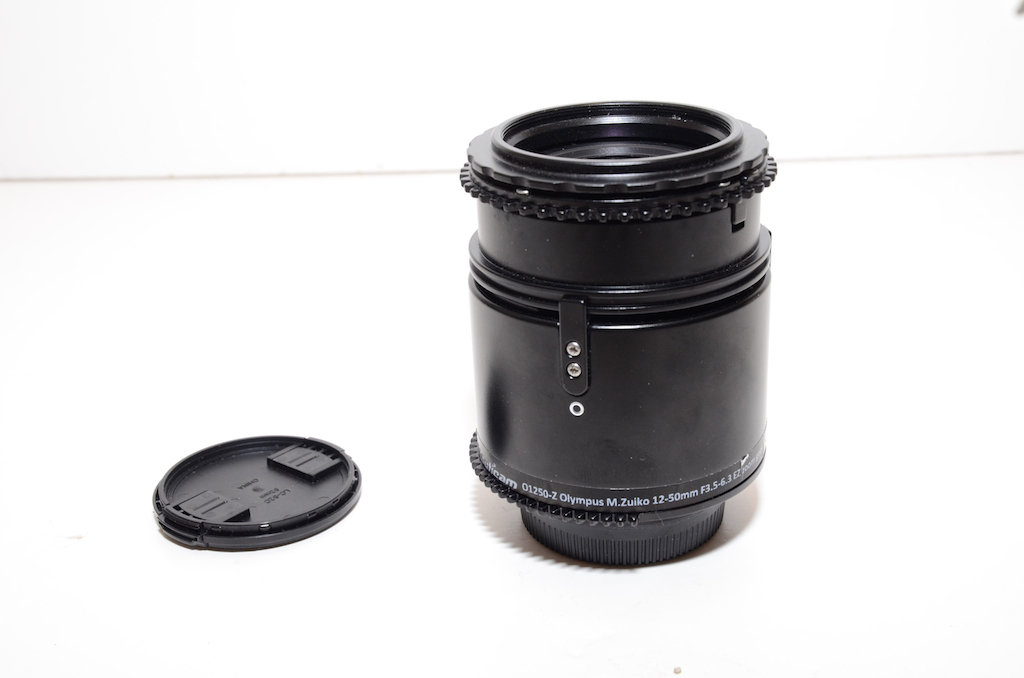 oly 12-50mm lens with gear.JPG
