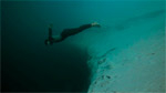 Guillaume Nery underwater base jump at Dean's Blue Hole Photo