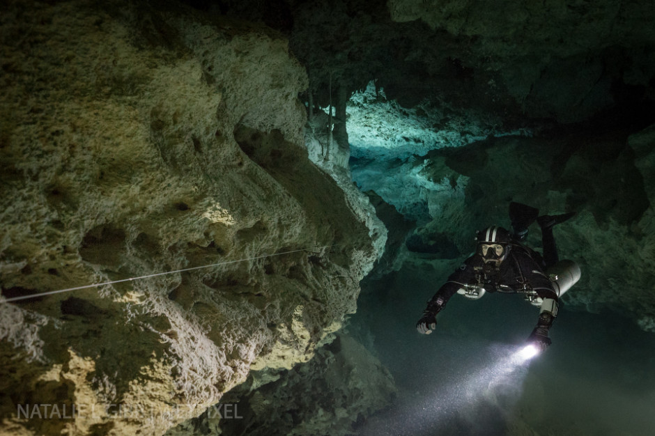 Nicholas White floats in front of a single video light, which adds depth to this canyon shot at Cenote Coop One.