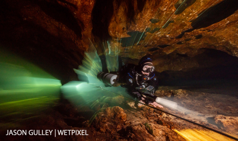 Hydrogeologist Dr. Patricia Spellman rides the flow out of a cave. Dr. Spellman uses observations from inside the aquifer to inform her research on how groundwater extraction impacts Florida's springs.