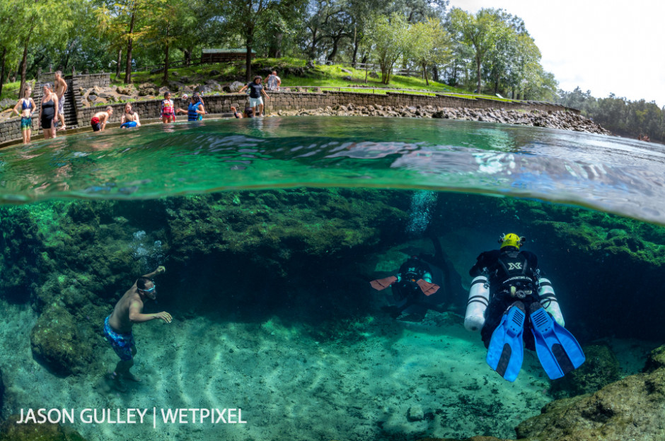 Cave divers enter the cave extending from Little River Spring, near Branford, Florida. Florida's springs are popular spots for swimmers as well as cave divers, especially in summer.