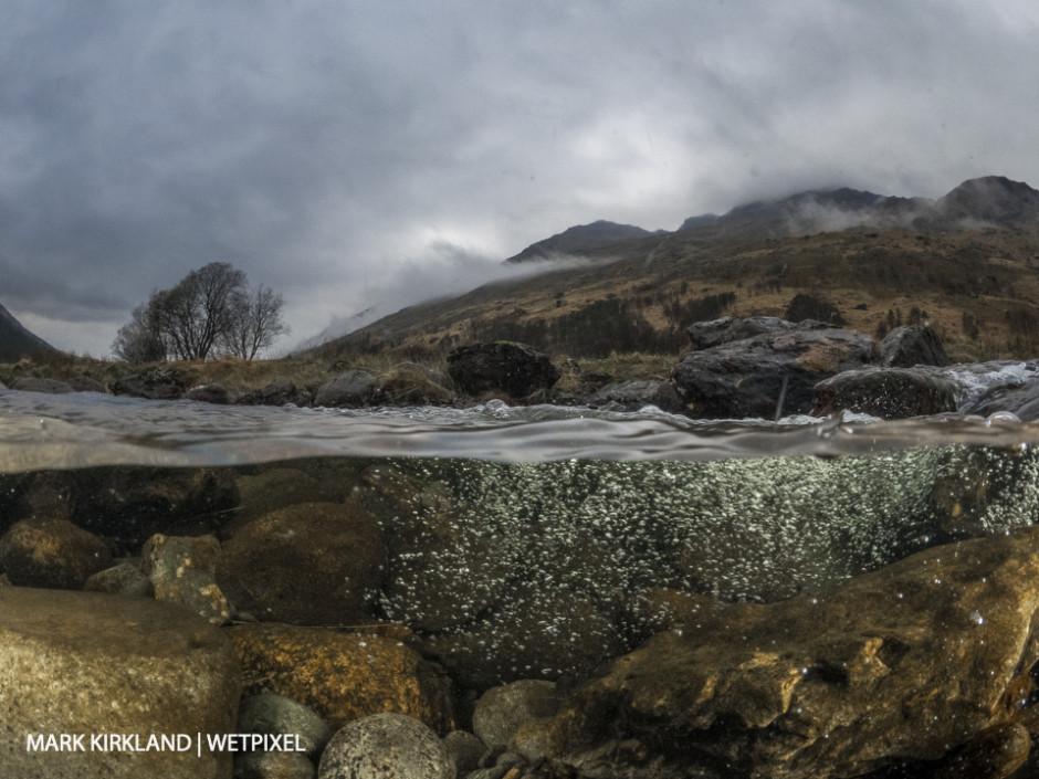 Split-level shot of Glen Kinglas, Scotland.