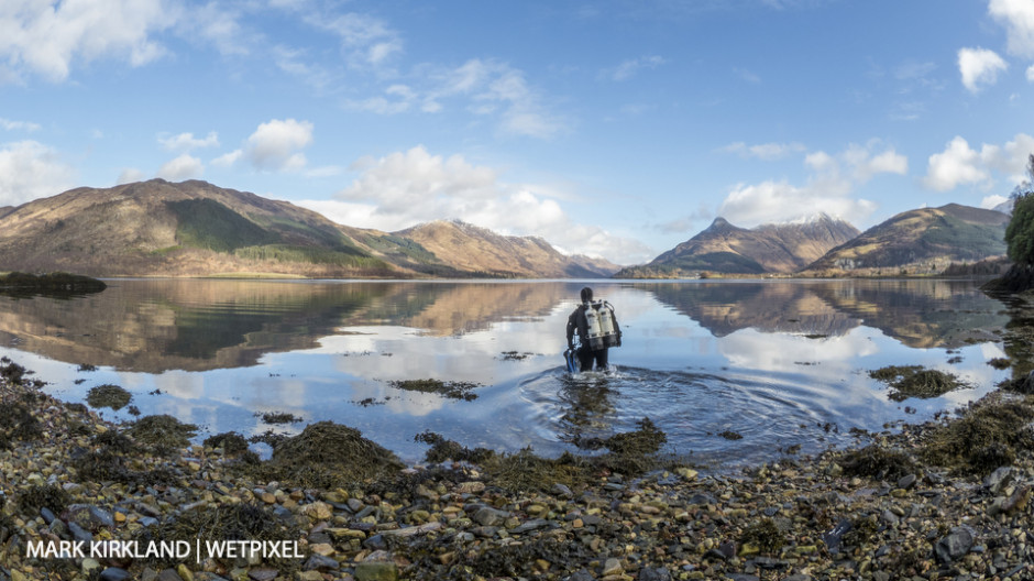 Diver entering Loch Leven, Scotland