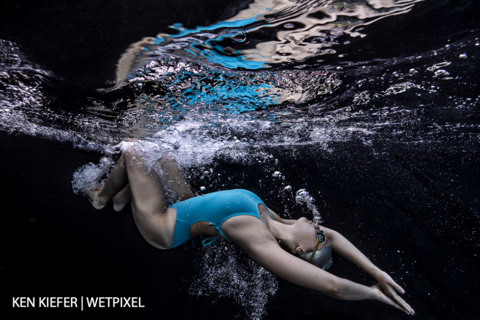 A swimmer doing a flip turn at full speed.
