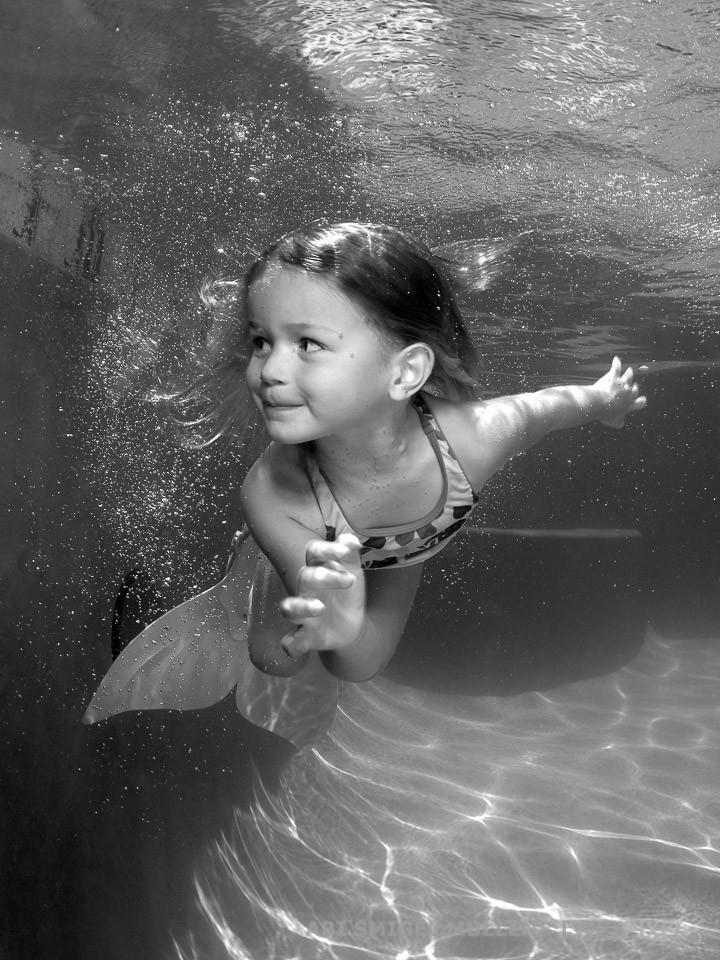 A cute underwater mermaid in black and white.