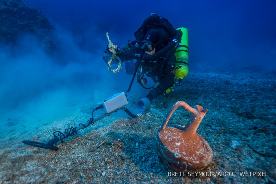 Greek technical diver Alexandros Sotiriou discovers an intact 'lagynos' ceramic table jug and a bronze rigging ring on the Antikythera Shipwreck.
