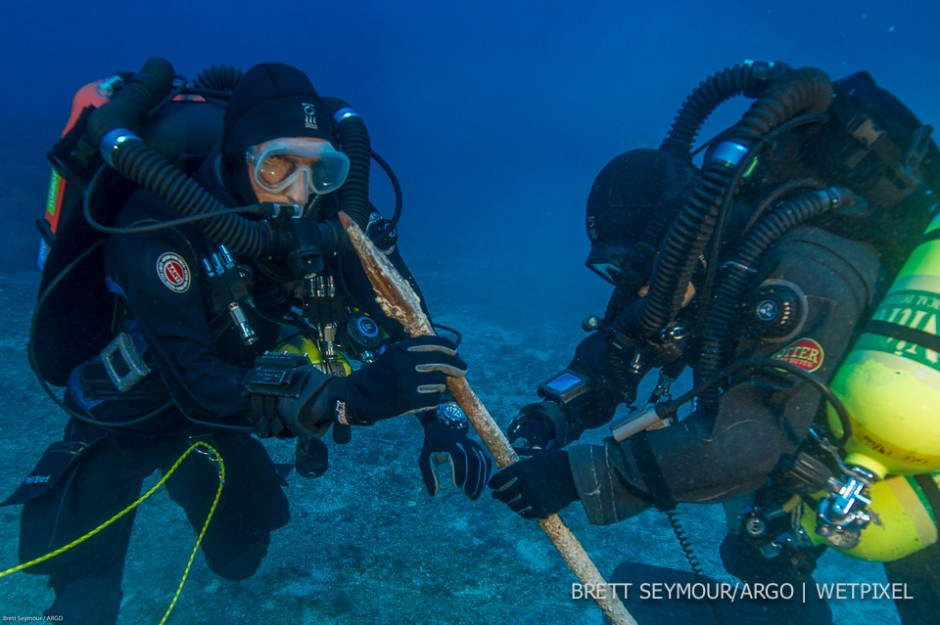 Technical divers Phil Short and Alexandros Sotiriou examine the bronze spear at 53 meters prior to recovery.