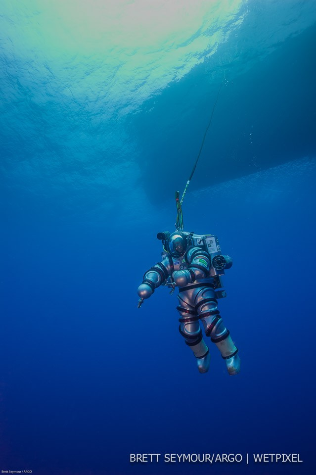 The Exosuit descends into the waters of Antikythera Greece.