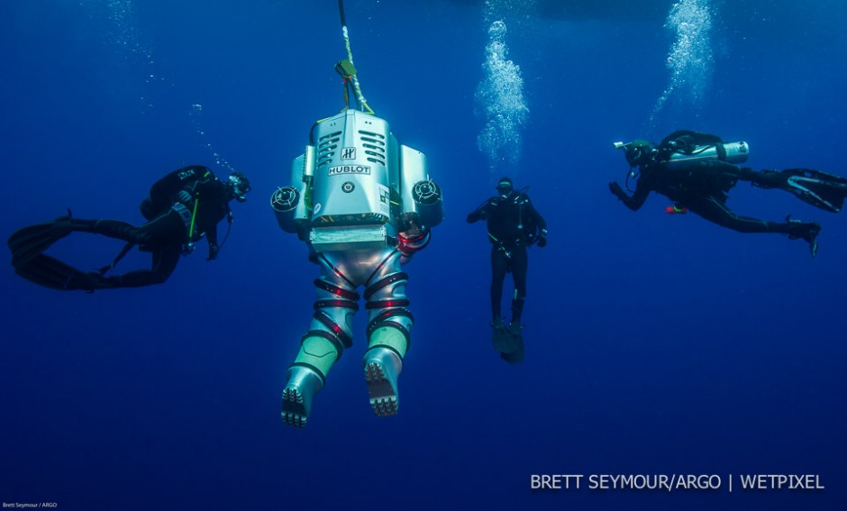 Safety divers from the Hellenic Navy swim with the Exosuit.