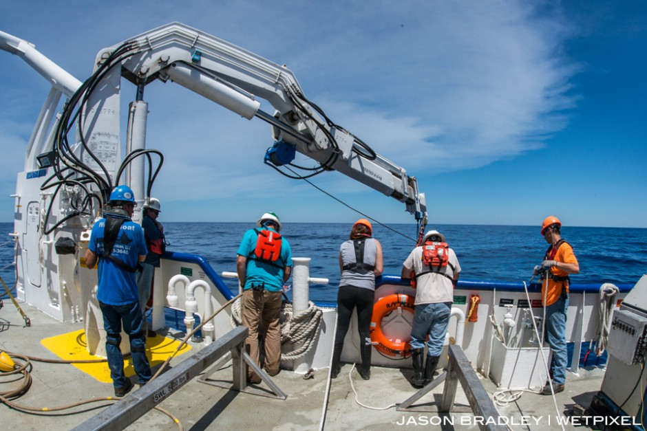 Scientists, engineers, and crew of LUMCON's (Louisiana Universities Marine Consotium) research vessel the R/V Pelican, watch Oceaneering's ROV descend into the Gulf of Mexico, and over the Mississippi Canyon.