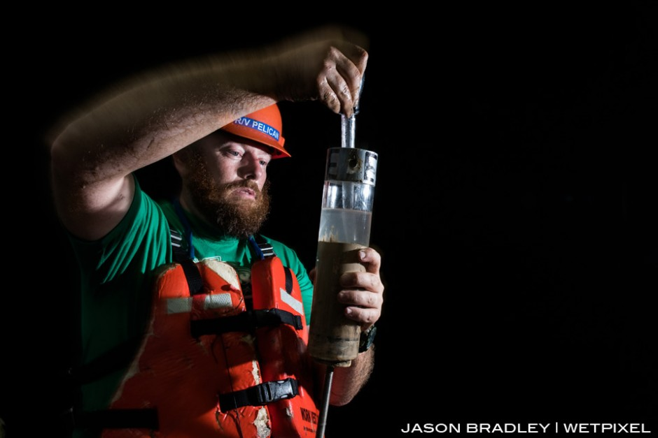 Dr. Cliff Nunnally, scientist for Project Woodfall, preps a core sediment sample from the deep-sea floor for further analysis.