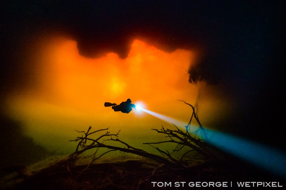Occassionaly heavy rains wash tannic water into Cenote Carwash turning the whole cenote a fiery red.