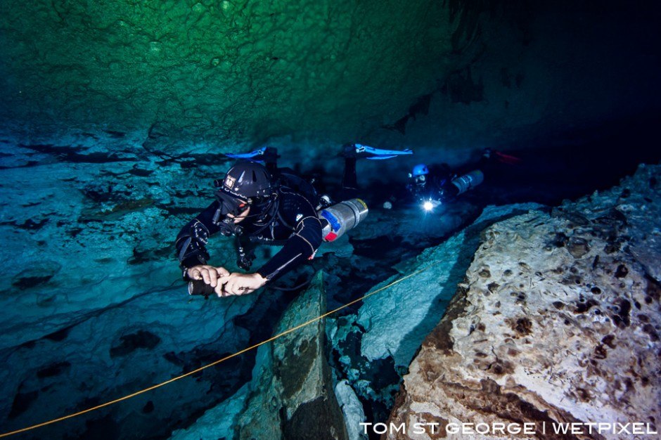 Above the halocline at Cenote Calavera. The saltwater and freshwater stain the cavern walls different colours.